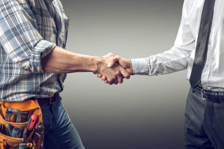 handshake between architect and contractor